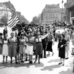 ** FILE ** French civilians with their hastily made American and