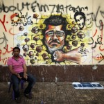 Mohammed Morsi in un graffito al Cairo-VOA