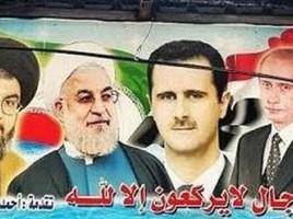 """Su un poster propagandistico, i volti dei """"vincitori"""" della guerra siriana: Hassan Nasrallah, Hassan Rouhani, Bashar Assad e Vladimir Putin"""