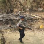 Soldato birmano in un villaggio